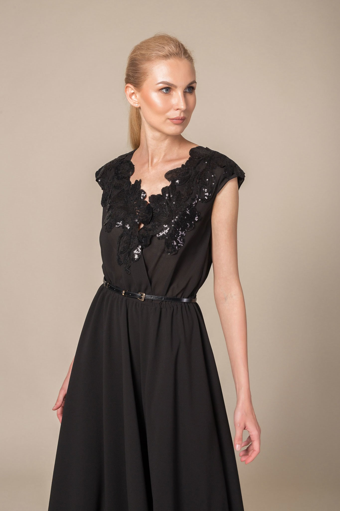 Floor length belted dress with cap sleeves and cinched waist